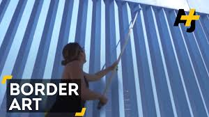 this artist is erasing the u s mexico border fence with blue