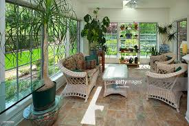 greenhouse sunroom sunroom greenhouse interior with casual wicker furniture plants