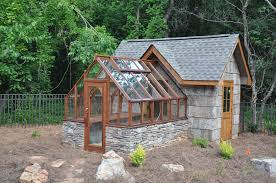 tudor greenhouse attached to an upscale garden shed yardwork
