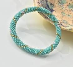 flower beads bracelet images Teal with flower glass beads nepal roll on bracelet glass seed jpg
