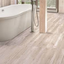 glazed porcelain wood effect floor tiles in stylish white