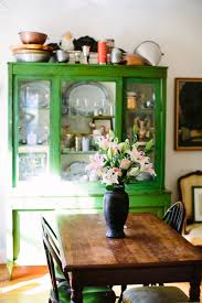 love the emerald green painted hutch with the classic farmhouse