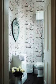 remodel small bathroom ideas with ornate mirror and wallpaper