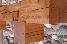 rustic wood mantels like forged iron bracket for cedar fireplace