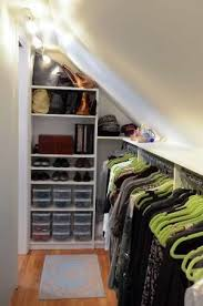 slanted ceiling closet design ideas pictures remodel and closet solution for angled ceiling in coat closet ideas for the