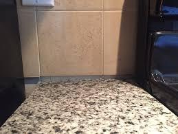 how to caulk a sink backsplash gap between backsplash granite