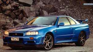 nissan skyline r34 wallpaper nissan skyline gt r r34 bkue color side view wallpaper