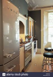 smeg fridge freezer in gray blue townhouse kitchen with wooden