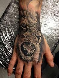 finger tattoo lioness lion tattoo ideas part 2