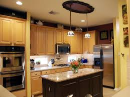kitchen electric range modern pendant light granite countertop