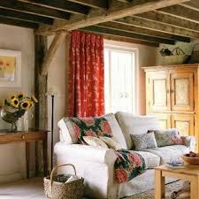 country living room with wooden beams and armoire selecting