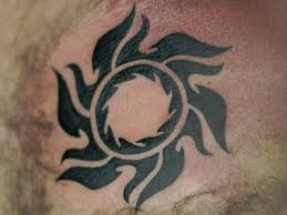 striking tribal sun tattoos