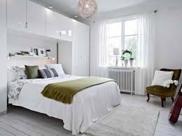 decorating with white walls and dark furniture bedroom apartment