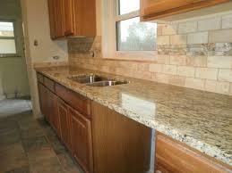 granite countertop white melamine cabinets travertine tile