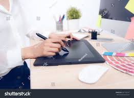 closeup female graphic designer using drawing stock photo