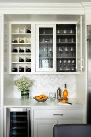 white kitchen cabinets with wood interior white wine glass cabinet with brown wood interior trim