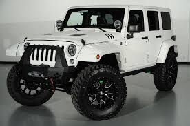 modified white jeep wrangler 2014 jeep wrangler unlimited in white kevlar front left view