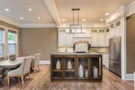 should kitchen cabinets match wood floors should i match my kitchen floors to the rest of my house