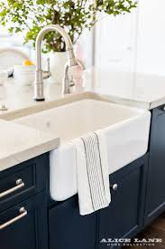 Brizo Faucets Kitchen by White Kitchen With Navy Blue Island Reno Ideas Home Bunch