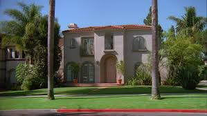 mediterranean style house day across corner upscale two style