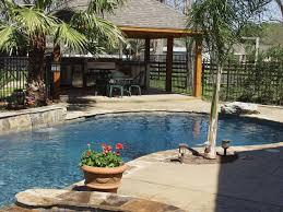 Tropical Backyard Pool Kitchen  Patio Ideas Pool Ideas - Custom backyard designs