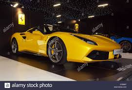 ferrari 488 convertible view of a yellow ferrari 488 spider on static display at the 2016
