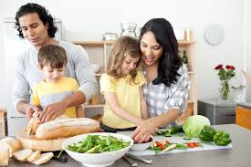 positive family preparing lunch together news from cooperative