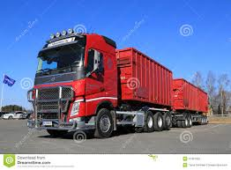 2014 volvo tractor for sale red volvo fh truck with full trailer and blue sky editorial