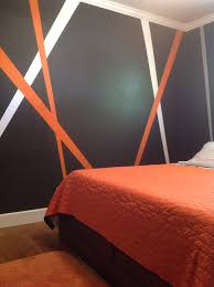 orange and green wall paint with storey bedstead also red stair