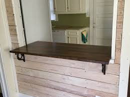 interior construction the corner of 8th and m we turned this 50 00 hunk of beech butcher block from ikea into this beautiful pass through counter height bar we still had almost two feel of butcher