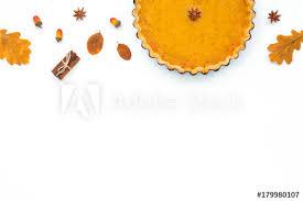 festive pumpkin pie on white background flat lay top