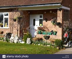 house with garden ornaments in sandbach cheshire uk stock