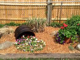 whiskey barrel spilling flower bed gardening pinterest