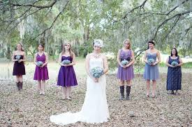 poses with mix and match bridesmaids some in cowboy boots