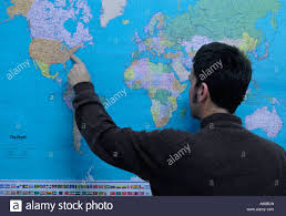 United States On A Map by Geography Teacher Pointing To United States On A World Political