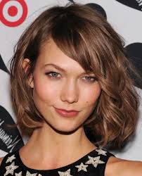 medium length hairstyle for oval face pictures of medium length haircut with bangs mid length layered