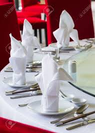 Oriental Dining Room Set by Close Up White Napkin On Chinese Dining Table Set Up Stock Photo