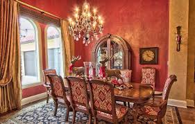 tuscan style dining room with red faux finish walls dashing