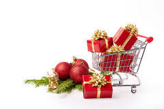 new year shopping shopping cart with gifts new year and christmas gifts stock photo
