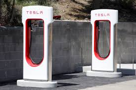 Hanging Charging Station Tesla Phasing Out Free Charging Even As White House Looks To