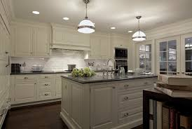 granite countertops for ivory cabinets ivory cabinets transitional kitchen carole freehauf