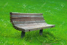 an old park bench isolated on grass back ground stock photo