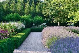 gravel paths lined with a bluestone curb surround a large central