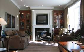 how to decorate a living room with tv above fireplace