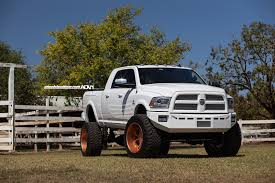 lifted ram 2500 on rose gold wheels meets a horse autoevolution