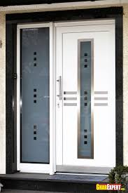 white wooden door with frozen glass on the middle beside high