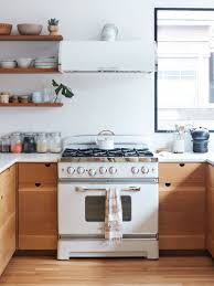do white cabinets go with black appliances the secret to white kitchen appliances look chic