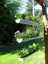 garden container ideas using pipes and decorated as hanging garden