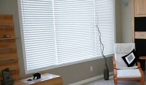 What Are Faux Wood Blinds Should I Choose Faux Wood Or Real Wood Blinds The Blinds Spot