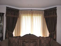 dark brown bay window curtains with cord tieback and valance also